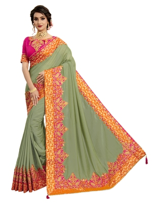 Green embroidered pure silk saree with blouse