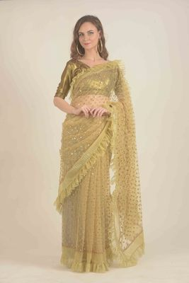 Rina Dhaka golden net saree with all over mirror work detail and hand embroidery in border with ruffle details