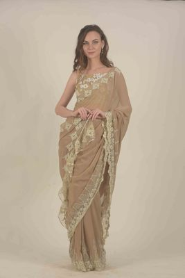 Rina Dhaka beige georgette saree with all over lace work detail border ruffle detail in palla