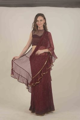 Rina Dhaka wine skirt saree with ruffle detail with gotta in tha border with sequence work blouse
