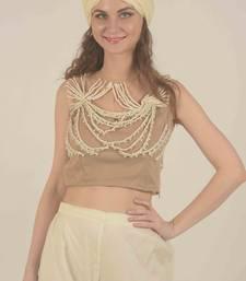 beige net blouse with dori work