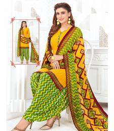 yellow printed crepe unstitched salwar with dupatta