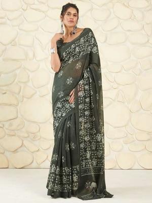 Dark green woven cotton saree with blouse