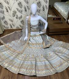 grey embroidered satin semi stitched bridal lehengas