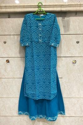 Blue Colored Bandhani Printed Kurti Along With Blue Skirt