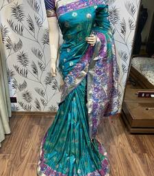 Turquoise embroidered pure banarasi saree with blouse