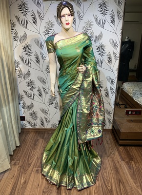 Green embroidered pure banarasi saree with blouse