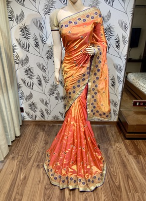 Orange embroidered pure raw silk saree with blouse