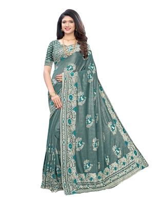 Teal woven lycra saree with blouse
