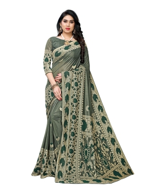Dark green woven lycra saree with blouse