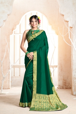 Dark green woven silk blend saree with blouse