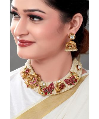 White satin layered necklace & earring set with gold toned broaches crusted with red semi precious stones.