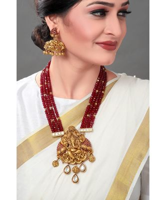 Gold Toned Earring & Necklace Set  With Kundan  & Ruby Red Semi Precious Beads