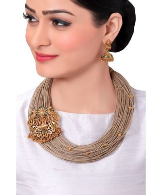 Festive Necklace Set With Gold Toned Temple Broach & Jute