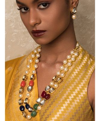 New Age Wonder Off White And Blue Kundan ,  Pearls And Jade Beads Necklace And Earrings Set.