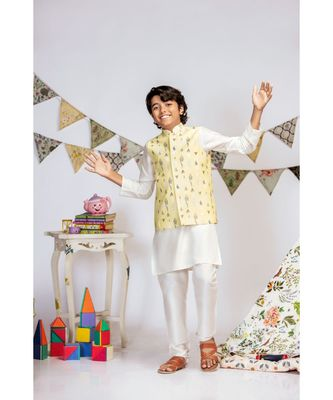Yellow Printed Silkmul Bandi with Off white Cotton Silk Kurta and Off white Cotton Silk Churidar