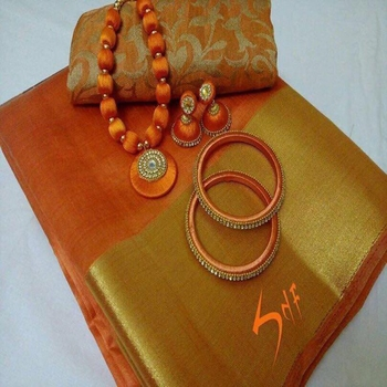 Orange plain tussar silk saree with blouse