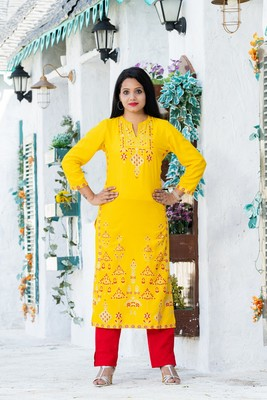 ADDICTION YELLOW RAYON GLITTER PRINTED STRAIGHT KURTA PAIRED WITH SOLID RED PANT