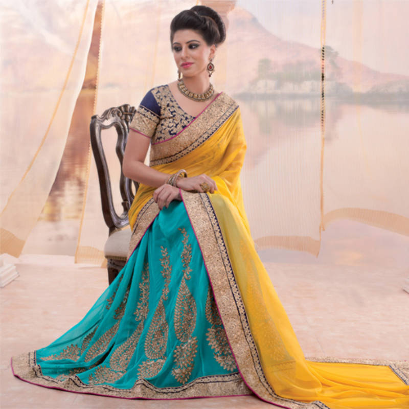 7019ac3e6f Yellow and sky blue embroidered georgette lehenga saree with blouse ...
