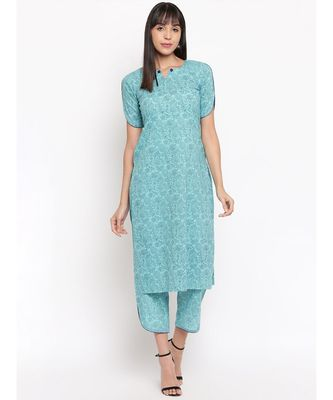 Light blue printed kurti with cut sleeves paired with matching trousers