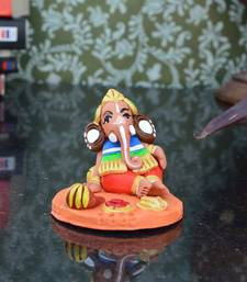 Buy Teracotta Lord Ganesha having Fruits thanksgiving-gift online