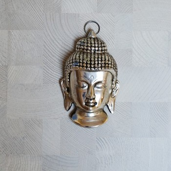 Metal Resting Buddha on Knee