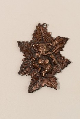 Metal wall hanging of Lord Ganesha on Maple Leaf