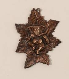 Buy Metal wall hanging of Lord Ganesha on Maple Leaf housewarming-gift online