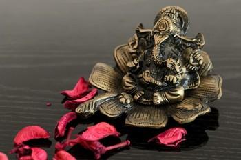 Metal Lord Ganesha on Flower
