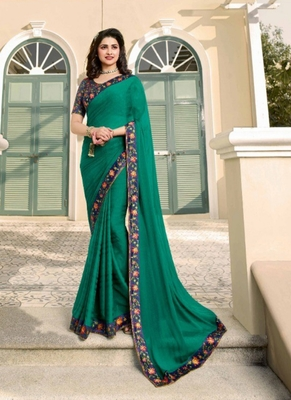 Dark sea green embroidered silk saree with blouse