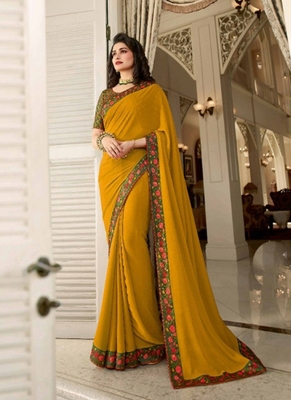 Mustard embroidered silk saree with blouse