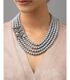 Grey multi-layered shell pearls with a base material of brass to provide rigidity