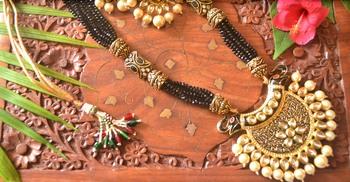 Designer floral elephant motif meenakari kundan studed onyx stone multilayer necklace set with earrings