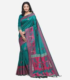 Teal hand woven raw silk saree with blouse