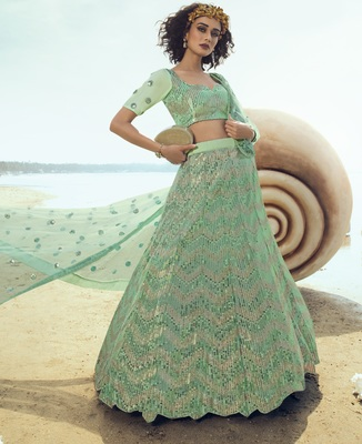 Green sequins embroidered net semi stitched lehenga