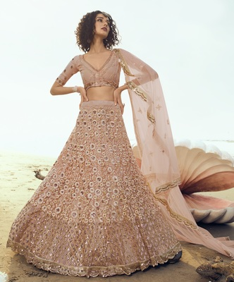 Peach sequins embroidered net semi stitched lehenga
