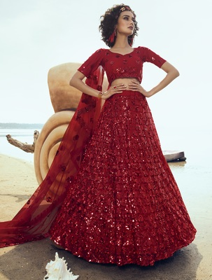 Red sequins embroidered net semi stitched lehenga