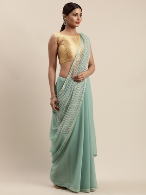 Sea green woven faux georgette saree with blouse
