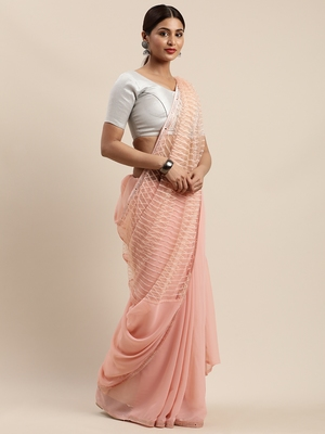 Peach woven faux georgette saree with blouse