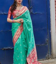 Cyan woven banarasi silk saree with blouse