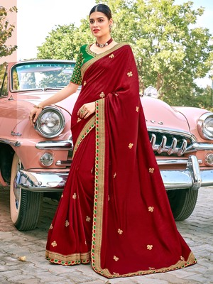 Red embroidered satin saree with blouse