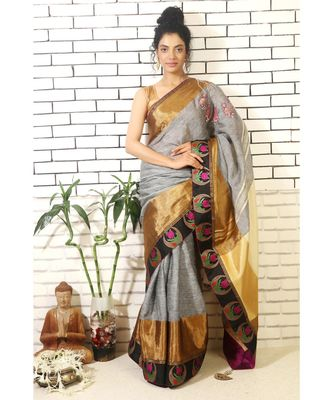 grey linnen saree with hand embroidered applique jhumkis on shoulder and brocade border and brocade blouse piece