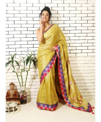 gold linnen tissue saree with applique work on pallu and brocade border and brocade blouse piece