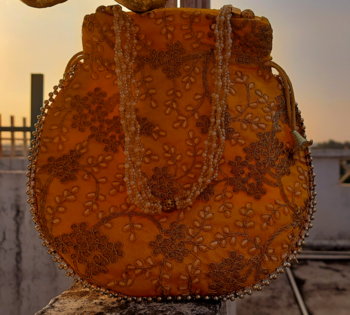 Orange Colored Sequin Worked Pearl Chained Potli Bag