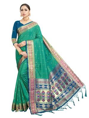 Teal green woven art silk saree with blouse