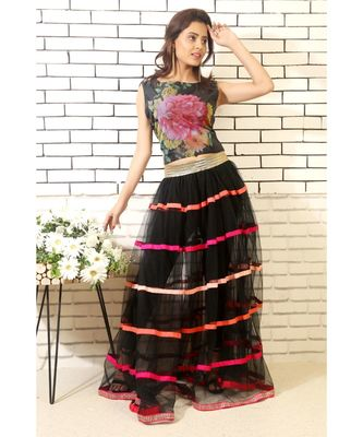 black net skirt with pink handmade silk ribbons and printed blouse with black slacks