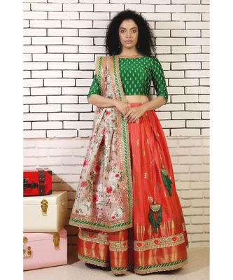 coral red south silk lehenga with embroidered blouse and organza dupatta with borders and cancan