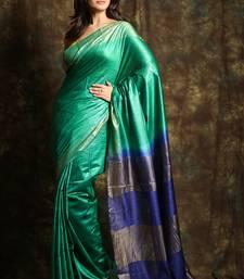 Aqua blue woven tussar silk saree with blouse