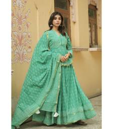 lehenga styled with pure hand block printed paplum top and dupatta with tassels
