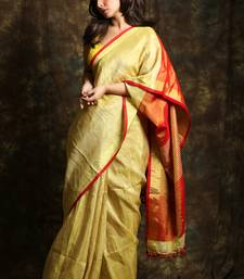 Golden woven tissue saree with blouse